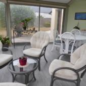 157 fauteuils rotin de jeu taupe veranda